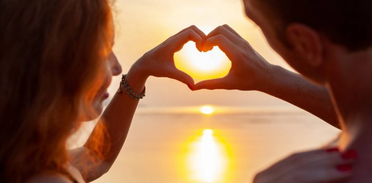 young-sexy-romantic-couple-love-happy-summer-beach-together-having-fun-wearing-swim-suits-showing-heart-sign-sundet-2